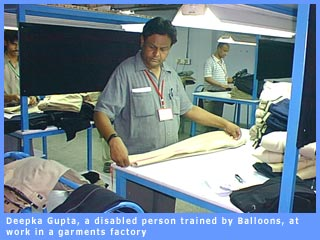 Deepak Gupta, a disabled person trained by Balloons, at work in a garments factor