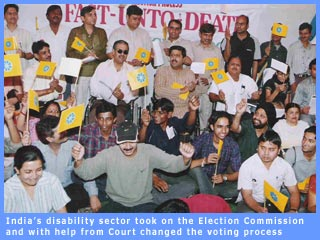 Picture of disability activists demanding  access during elections