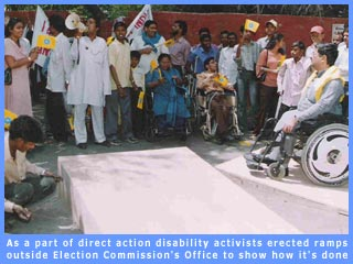 Picture of disability activists erecting ramps outside Election Commission's office