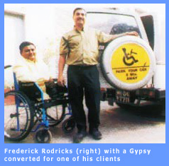 Ferdinand Rodrick with a disabled client.