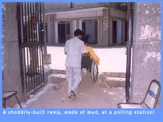 Picture of a mud ramp which is supposed to provide access to polling stations.