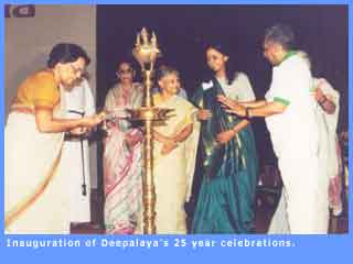 Picture of the inaugural lamp being lit to mark the start of Deepalaya's Silver Jubilee function.