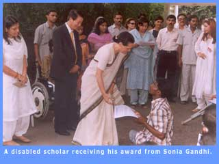 Picture of a disabled scholar receiving his award fromSonia Gandhi