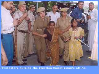 Picture of protesters outside the Election Commissioner's office.