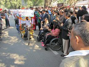 Dr. C. Chandramouli flagging off a tricycle rally