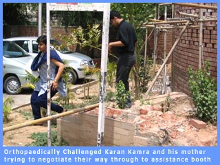 Karan and his mother negoiating a dismantled D.U gate to reach an assistance booth