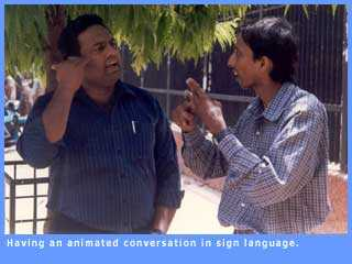 Picture of two people talking animatedly in sign language