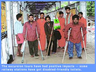 Picture of persons with disability at a railway station