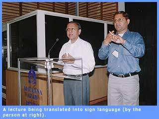 Picture of a lecture being translated into sign language